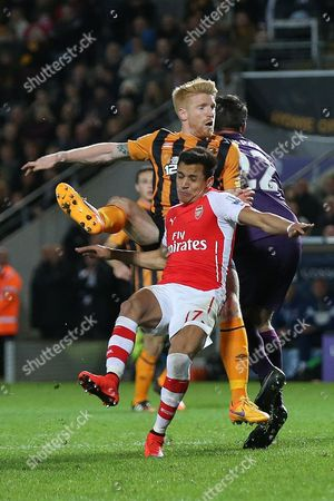 Steve Harper and Paul McShane of Hull City combine to block Alexis Sanchez of Arsenal
