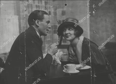 Ted Trevor As Bob Coolev And Miss Justine Johnstone As Polly Brown In The Play 'polly Preferred' At The Royalty Theatre. Box 556.