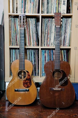 Buckinghamshire United Kingdom - May 22: A Pair Of Vintage Martin Acoustic Guitars Including A 1920 Martin 0-21 Model (L) Belonging To English Rock Musician Bernie Marsden On May 22