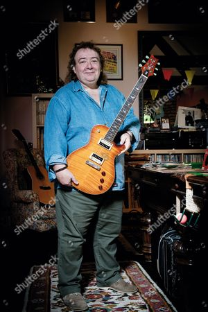 Buckinghamshire United Kingdom - May 22: Portrait Of English Rock Musician Bernie Marsden Photographed With A Prs Se Bernie Marsden Prototype Guitar At His Home In Buckinghamshire On May 22 2014. Marsden Is Best Known As A Guitarist With Rock Group Whitesnake