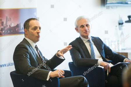 Stock Image of Lord Ian Livingston, Cabinet Minister for Trade and Investment, with Alex Brummer