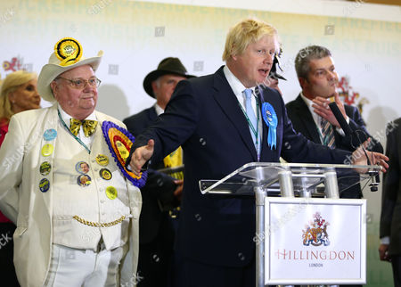Howling Laud Hope of the The Official Monster Raving Loony Party listens as Boris Johnson makes his winner's speech