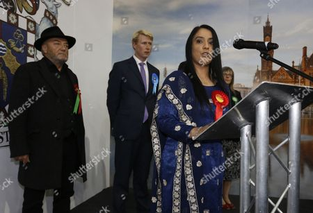 George Galloway watches as Labour candidate Naz Shah makes her victory speech