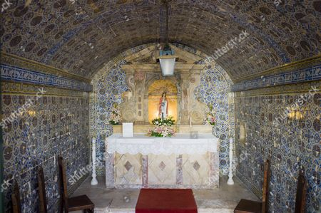 Fortress da Ponta da Bandeira, typical Portugese chapel decorated with ceramic tiles in the Fortaleza da Ponta da Bandeira, with the patron saint, Santa Barbara, Lagos, Algarve, Portugal, Europe
