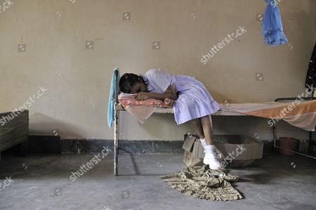Sick girl, girls' dormitory, school for the blind, Tangalle, Sri Lanka, Ceylon, South Asia, Asia