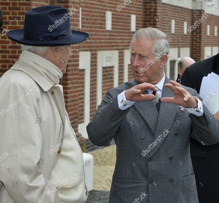 Prince Charles with Leon Krier, left who designed the estate
