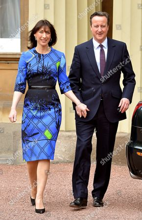 Prime Minister David Cameron leaves Buckingham Palace with his wife Samantha Cameron