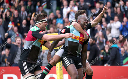 Harlequins' Ugo Monye (R) celebrates  with Harlequins' Ollie Lindsay-Hague (hidden)  & Harlequins' Matt Shields (L) after he scores the first try during his final home game before retirement