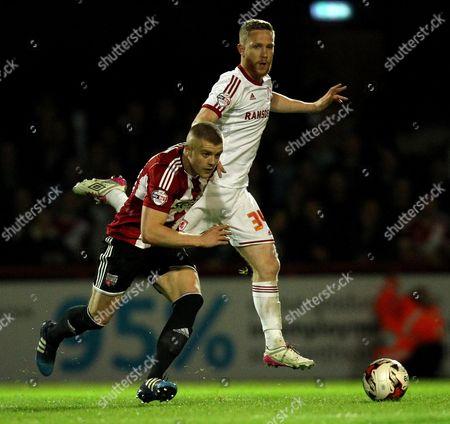 Brentford's Jake Bidwell gets past Middlesbrough's Adam Forshaw