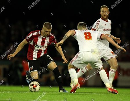 Brentford's Jake Bidwell takes on Middlesbrough's Adam Clayton