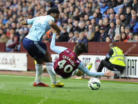 Aston Villa's Jack Grealish is fouled by West Ham United's Alexandre Song
