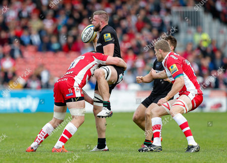 Stock Photo of London Irish replacement Kieran Low is tackled by Gloucester Lock Tom Savage