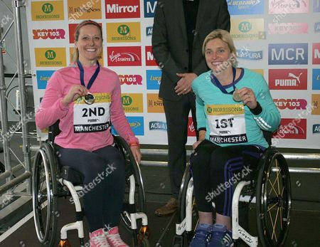 Mel Nicholls (2nd) and Shelly Woods (1st) in the Womens Elite Wheelchair race