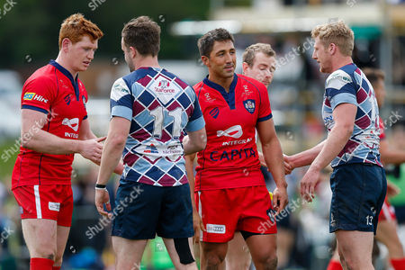 Bristol Rugby replacement Jack Tovey and Inside Centre Gavin Henson are congratulated by Rotherham Titans Winger Michael Keating and Outside Centre Lloyd Hayes after Bristol Rugby win the match to advance to the play off final