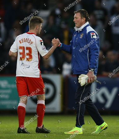 Dave Beasant of Stevenage shakes hands with Ben Kennedy of Stevenage after the final whistle