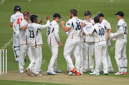 Matt Coles of Kent (26) celebrates with teammates after dismissing Glamorgan batsman Colin Ingram.