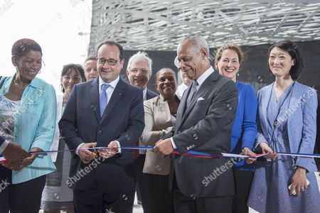 French President Francois Hollande (2nd L) and of the Regional Council of the French overseas department of Guadeloupe Victorin Lurel (3rd R), flanked by Minister for Ecology, Sustainable Development and Energy Segolene (2nd R) and Culture Minister Fleur Pellerin (R), inaugurate the Memorial ACTe, the Caribbean Centre of Expression and Memory of Slavery and the Slave Trade