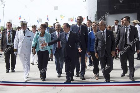 French President Francois Hollande (C), flanked by French Overseas Territories Minister George Pau-Langevin (2nd L), Minister for Ecology, Sustainable Development and Energy Segolene (3rd R) and President of the Regional Council of the French overseas department of Guadeloupe Victorin Lurel (2nd R), arrives to inaugurate the Memorial ACTe, the Caribbean Centre of Expression and Memory of Slavery and the Slave Trade.