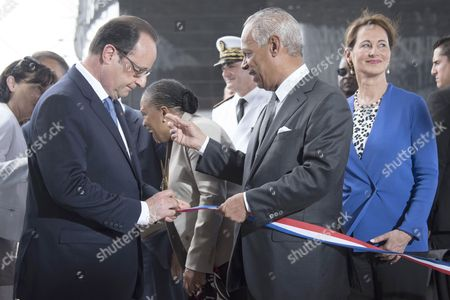 French President Francois Hollande (L) and president of the Regional Council of the French overseas department of Guadeloupe Victorin Lurel (2nd R), flanked by Minister for Ecology, Sustainable Development and Energy Segolene, inaugurate the Memorial ACTe, the Caribbean Centre of Expression and Memory of Slavery and the Slave Trade.