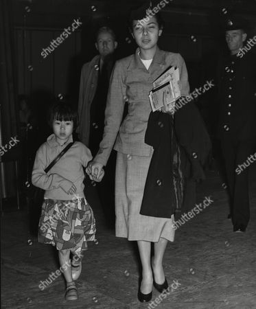 Stock Picture of Liao Wen-ying With Air Hostess Ester Garcia. Seven-year-old Liao Is To Be Reunited With Her Mother After Five Years.