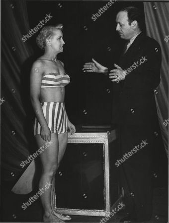 Stock Picture of Demonstration By Lee Orme Hypnotist Who Claims That He Can Make A Girl Walk On The Surface Of Water. He Is Pictured With Olivia Ward 28 Of Cheadle Cheshire During A Demonstration At Salford Central Mission. Box 0554 020215 00098a.jpg.