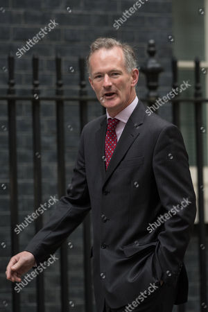 Stock Image of John Penrose MP arrives before the first post-election Cabinet meeting at 10 Downing Street.
