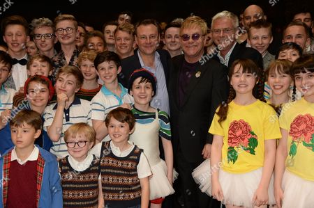 Lee Hall, Sir Elton John and Stephen Daldry with performers