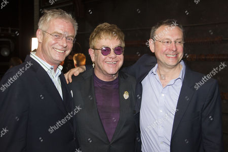 Stephen Daldry (Director), Sir Elton John (Music) and Lee Hall (Author) backstage after the curtain call for the 10th birthday of Billy Elliot at the Victoria Palace Theatre