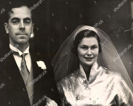 Stock Photo of Anthony Wagner Richmond Herald And Secretary Of The Order Of The Garter With His Bride Gillian Graham On Their Wedding Day.
