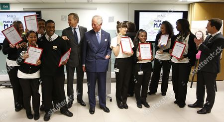 Britain's Prince Charles, center, looks around as the CEO of Marks and Spencer, Marc Bolland, center left, announces all the Prince's Trust 'Mark your Mark participants at this ceremony have been employed by Marks and Spencer, in London, Wednesday May 13, 2015. The Prince's Trust 'Make your Mark' scheme is aimed at youth unemployment, giving underprivileged and socially disadvantaged young people opportunities to work. (AP Photo/Alastair Grant, Pool)