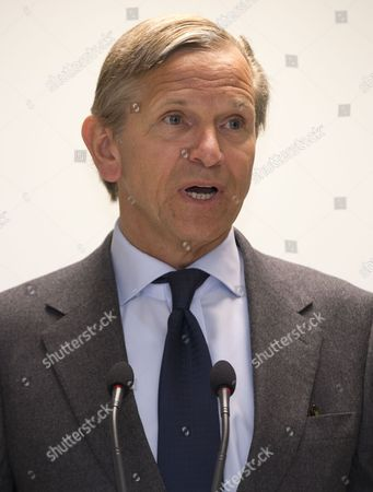 CEO of Marks and Spencer Marc Bolland talks to Prince's trust participants at a branch of Marks and Spencer as Britain's Prince Charles makes a visit in London