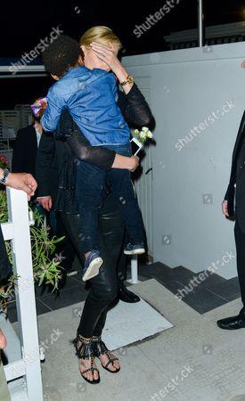 "Charlize Theron and their son Jackson Theron leave the restaurant ""Chez Tetou"" the Gulf"