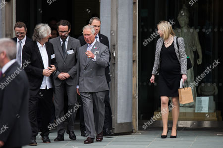 Prince Charles talking to TV Producer Phil Redmond as he leaves a visit with Camilla Duchess of Cornwall to the World Museum in Liverpool.