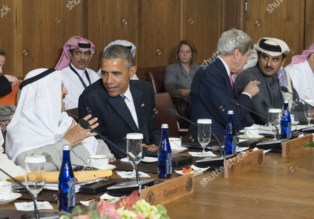Barack Obama talks to Sheikh Mohammed Al Khalid M Al Sabah of Kuwait while U.S. Secretary of State John Kerry talks to Sheikh Tamim bin Hamad Al Thani, Amir of the State of Qatar, during a working lunch at the Gulf Cooperation Council