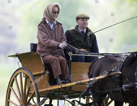Lady Brabourne driving her carriage through the show ground.