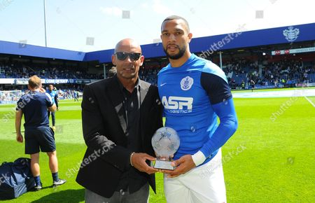 Matt Phillips of QPR is presented with an award by former player Trevor Sinclair before kick off