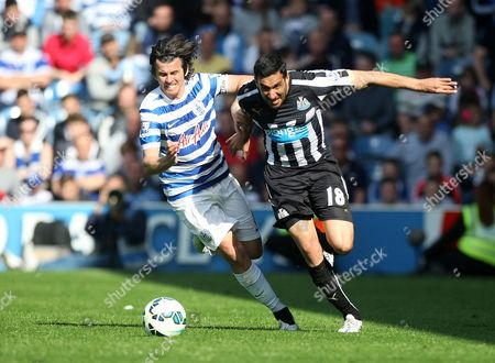 Jonas Gutierrez of Newcastle in action with Joey Barton of QPR