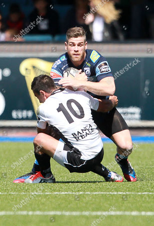 Gavin Evans of Cardiff Blues is tackled by Luciano Orquera of Zebre.