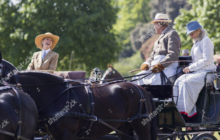 Lady Brabourne jokes with Prince Philip before the start of the Laurent-Perrier Meet of the British Driving Society.