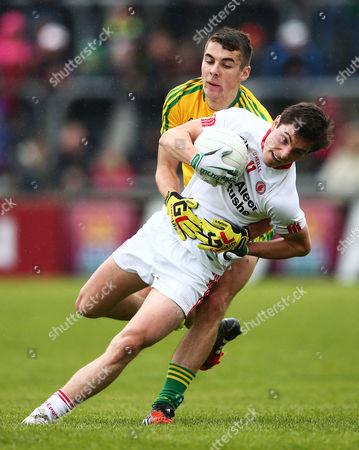 Donegal's Michael Carroll tackles David Mulgrew of Tyrone