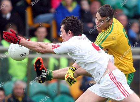 Donegal's Michael Carroll denied by Tyrone's Colin Campbell