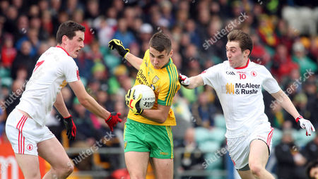 Donegal's Michael Carroll with Tyrone's Johnny Harkin and Michael Corless