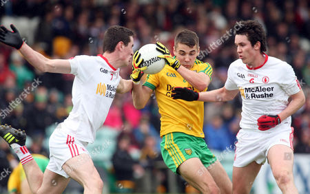 Stock Photo of Donegal's Michael Carroll with Tyrone's Johnny Harkin and Michael Corless
