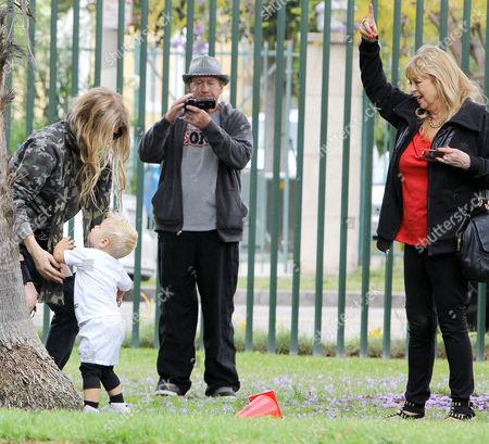 Stock Photo of Fergie Duhamel, Axl Duhamel and grandparents Jon Patrick Ferguson, Theresa Ann Ferguson