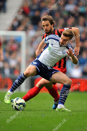 Stock Picture of James Morrison of West Bromwich Albion holds off Nico Kranjcar of  Queens Park Rangers