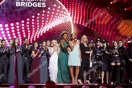 The hosts of the show Arabella Kiesbauer, Alice Tumler, and Mirjam Weichselbraun on stage with all artist of the 1. semifinal during a dress rehearsal
