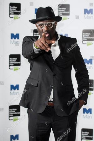 Author Alain Mabanckou poses during a photo-shoot before the announcement of the 2015 Man Booker Prize winner at the Victoria and Albert Museum.