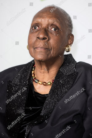Stock Photo of Author Maryse Conde poses during a photo-shoot before the announcement of the 2015 Man Booker Prize winner at the Victoria and Albert Museum.