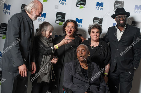 Stock Photo of (L-R) Authors Laszlo Krasznahorkai, Fanny Howe, Hoda Barakat, Maryse Conde, Marlene Van Niekerk and Alain Mabanckou pose during a photo-shoot before the announcement of the 2015 Man Booker Prize winner at the Victoria and Albert Museum.