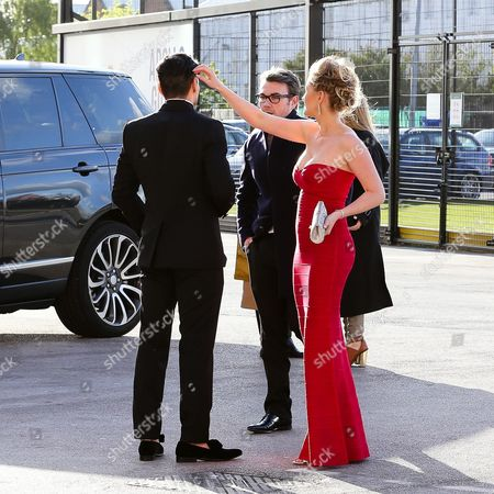 Radamel Falcao spends time checking his new haircut before making his entrance, with wife Lorelei Taron